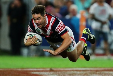 Debutant: New Maroon Aidan Guerra crosses for the Roosters. Source: The Daily Telegraph